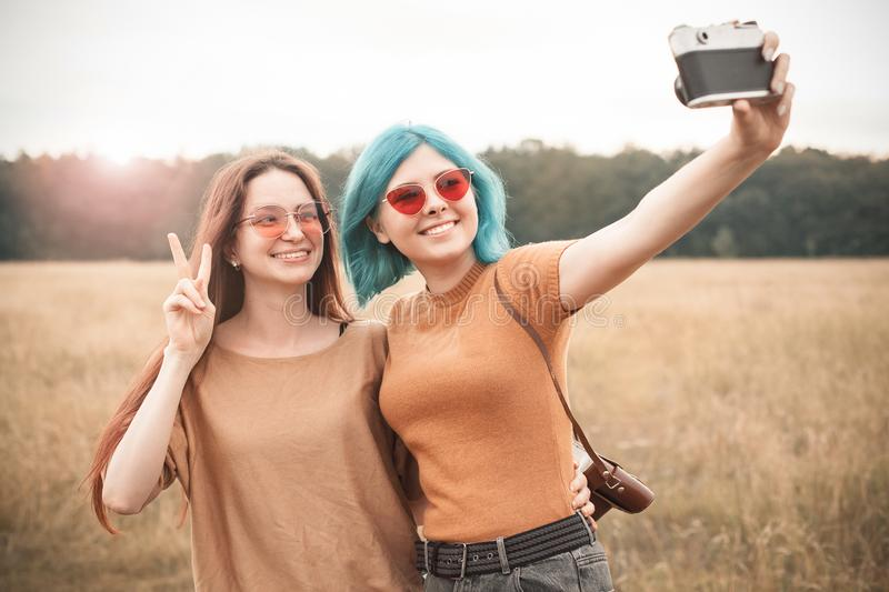 Two young women making self portrait royalty free stock image