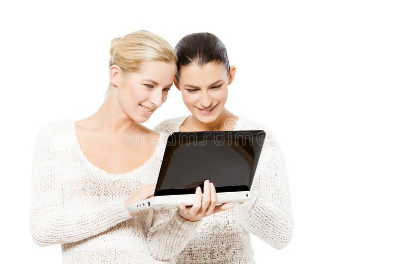 Download Two Young Women With Netbook Stock Image - Image: 23114817