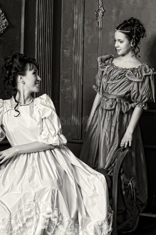 Two young women in retro dresses stock photos