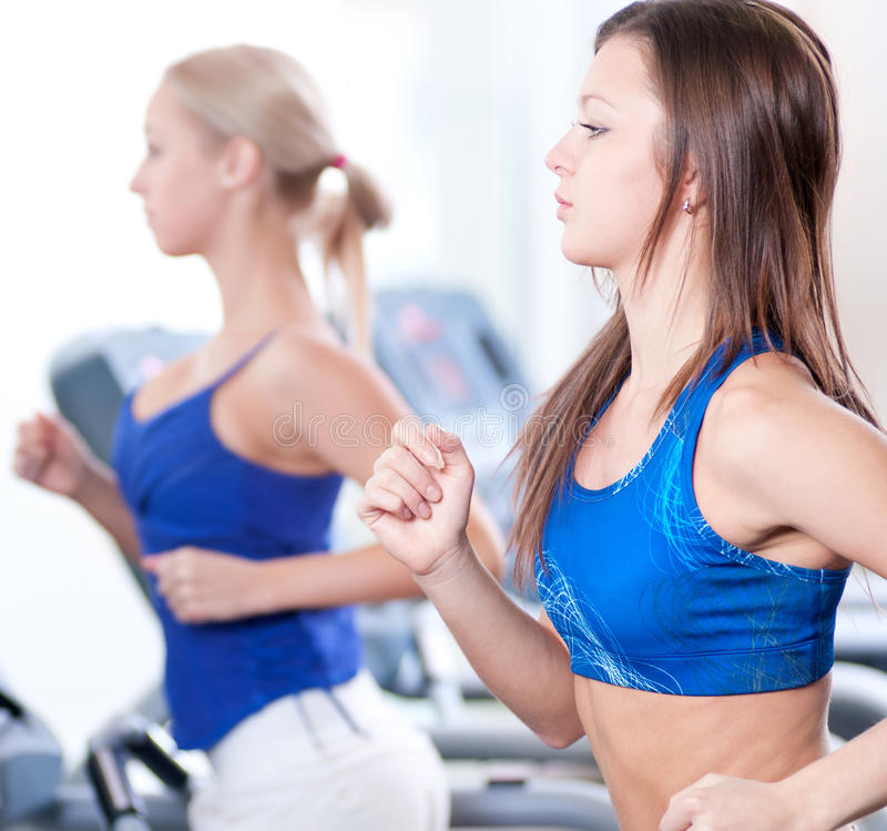 Download Two Young Women Run On Machine In The Gym Stock Image - Image: 25790713