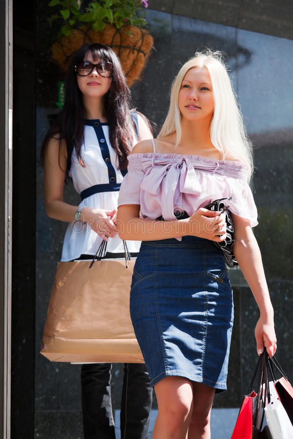Download Two Young Fashion Women With Shopping Bags Stock Image - Image of business, friendship: 20581991