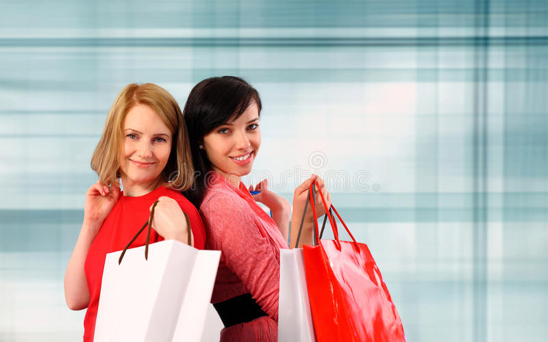 Download Two young women shopping stock photo. Image of smile - 23346008