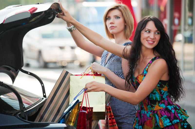 Download Two Young Fashion Women With Shopping Bags Next To Car Trunk Stock Photo - Image: 16828682