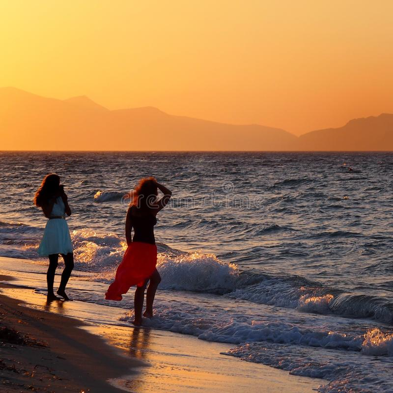 Beautiful Young Women Standing Together On The Beach Stock