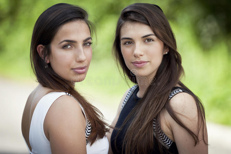Two young women smiling stock images