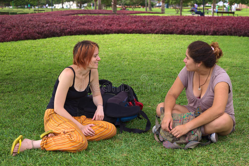 Download Two Young Women Talking In Park Stock Photo - Image of traveling, miraflores: 24630334