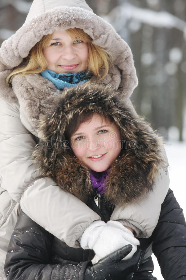 Download Two Young Women In Winter Day Royalty Free Stock Photos - Image: 12955178