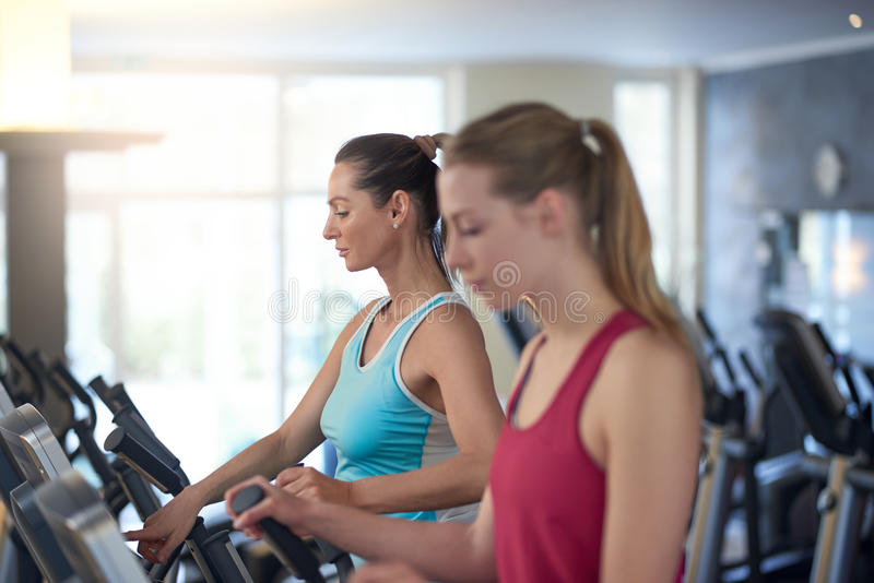 Two young women working out in a gym stock photos