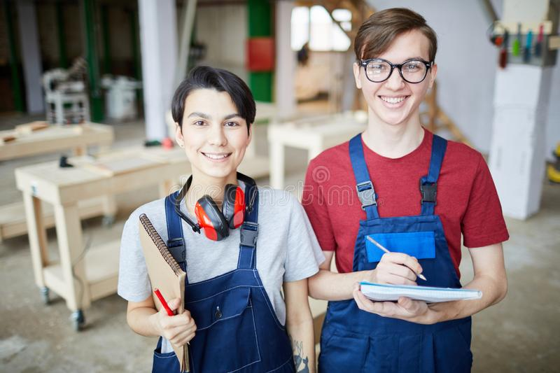 Two Young Workers at Factory royalty free stock image