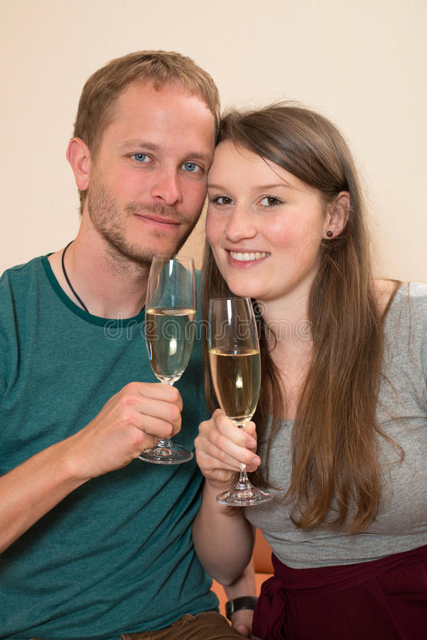 Twosome with Champagner. Young men and women drinking Champagner stock image
