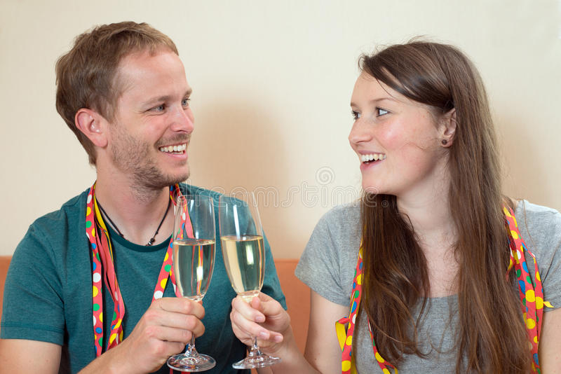 Twosome with Champagner. Young men and women drinking Champagner royalty free stock photography