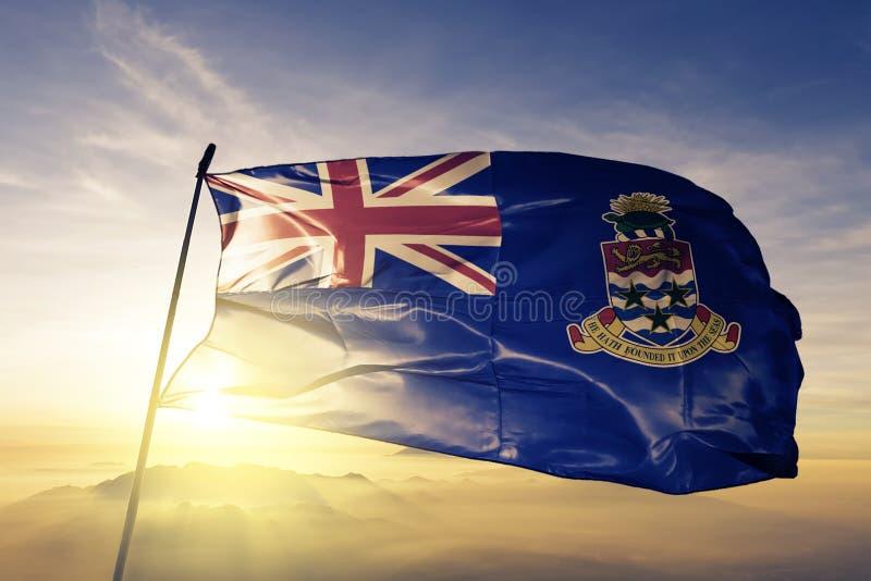 Tyg för torkduk för Caymanöarna nationsflaggatextil som vinkar på överkanten vektor illustrationer