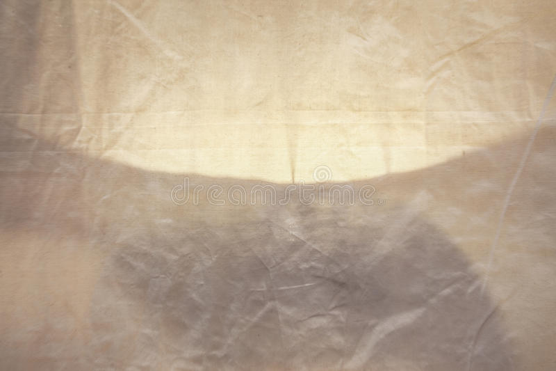 Tyg med ljus och skugga, abstrakt begrepp, textur, bakgrund. royaltyfri fotografi