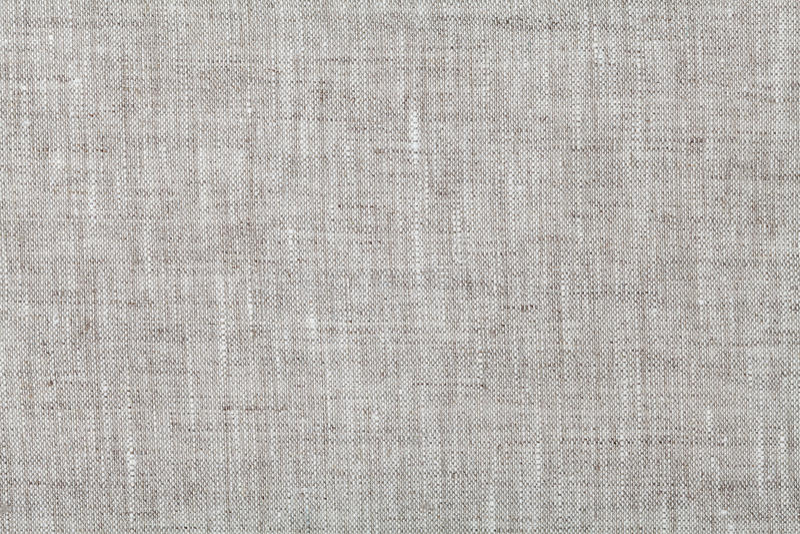 Tygbakgrund i neutrala grå färger färgar, linnetextur arkivfoto