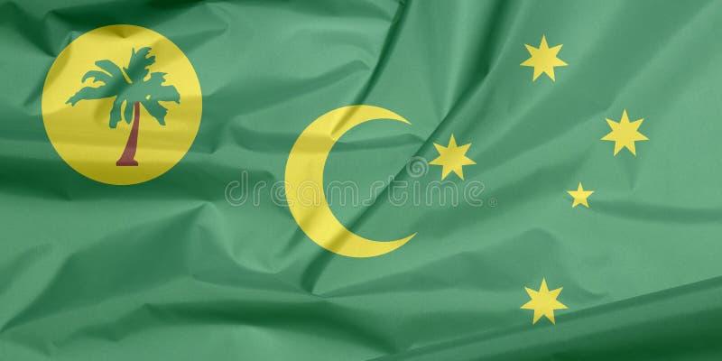 Tygflagga av CocosKeeling öar Veck av bakgrund för flagga för CocosKeeling öar royaltyfria bilder