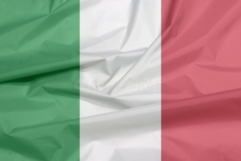 Tygflagga av Italien Veck av italiensk flaggabakgrund arkivbild