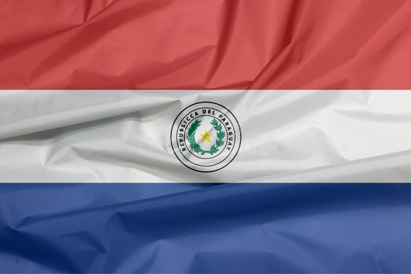 Tygflagga av Paraguay Veck av paraguayansk flaggabakgrund royaltyfri illustrationer