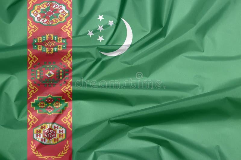 Tygflagga av Turkmenistan Veck av turkmensk flaggabakgrund arkivfoton