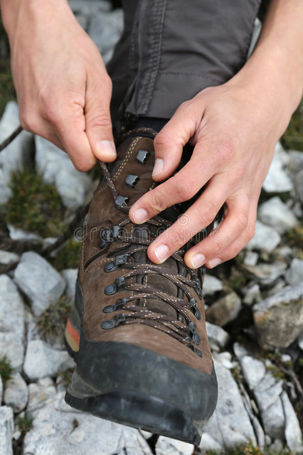 Tying the hiking boots royalty free stock image