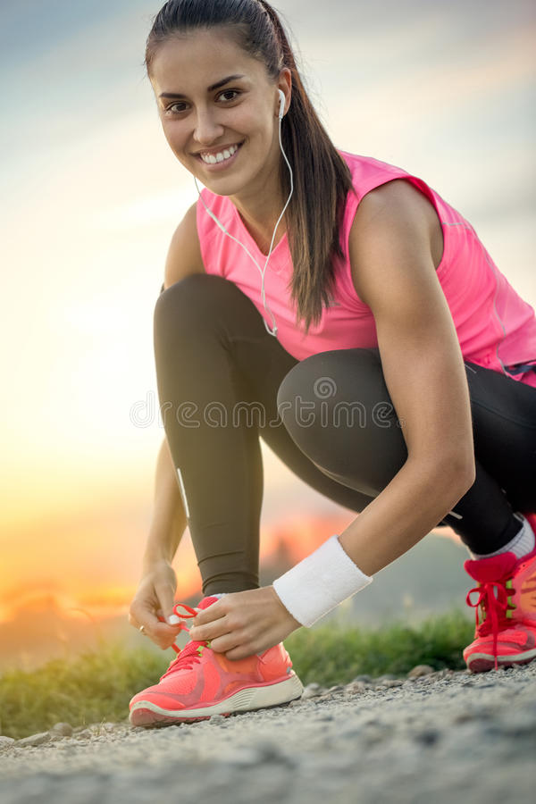 Tying sport shoe royalty free stock photography