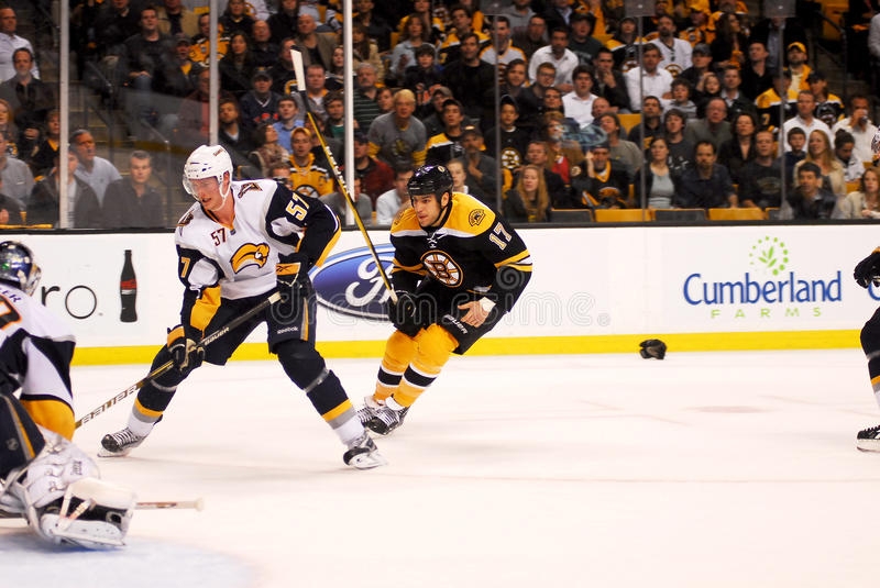 Tyler Myers Buffalo Sabres & Milan Lucic. Tyler Myers (57) of the Buffalo Sabres keeps the puck away from the Boston Bruins forward Milan Lucic (17 royalty free stock images