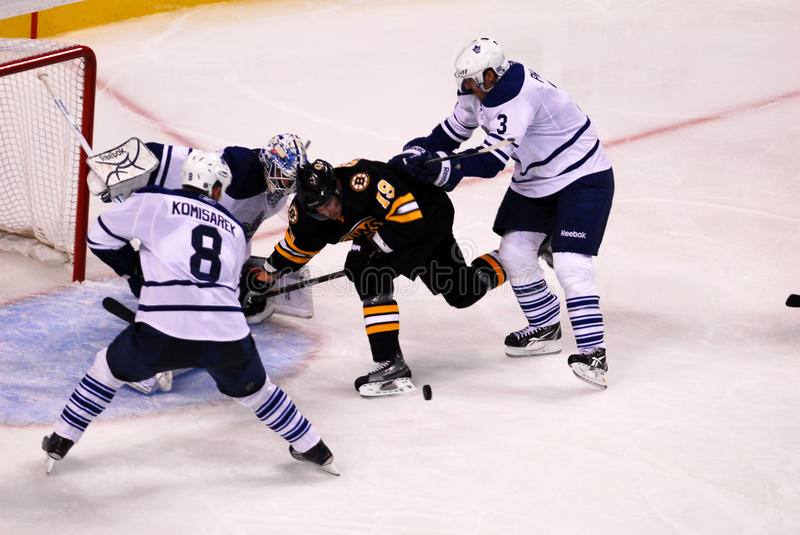 Tyler Seguin, Boston Bruins. Leafs Captain Dion Phaneuf (3) pushes Bruins forward Tyler Seguin as he tries to deflect a puck past Jonas Gustavsson royalty free stock photography