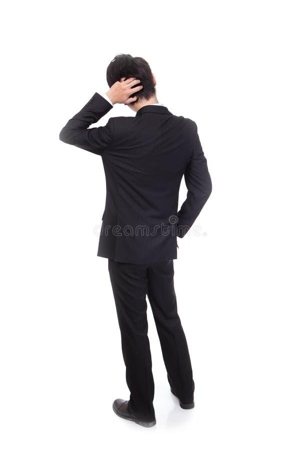 Tylni widok młody biznesowy mężczyzna wprawiać w zakłopotanie zdjęcie royalty free