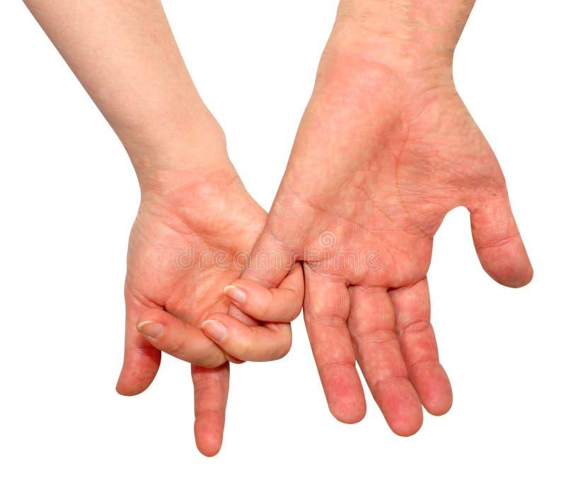 Tylni widok ręki kobiecy i męski, trzyma ręki odizolowywać na białym tle, romantyka, intymność zdjęcia royalty free