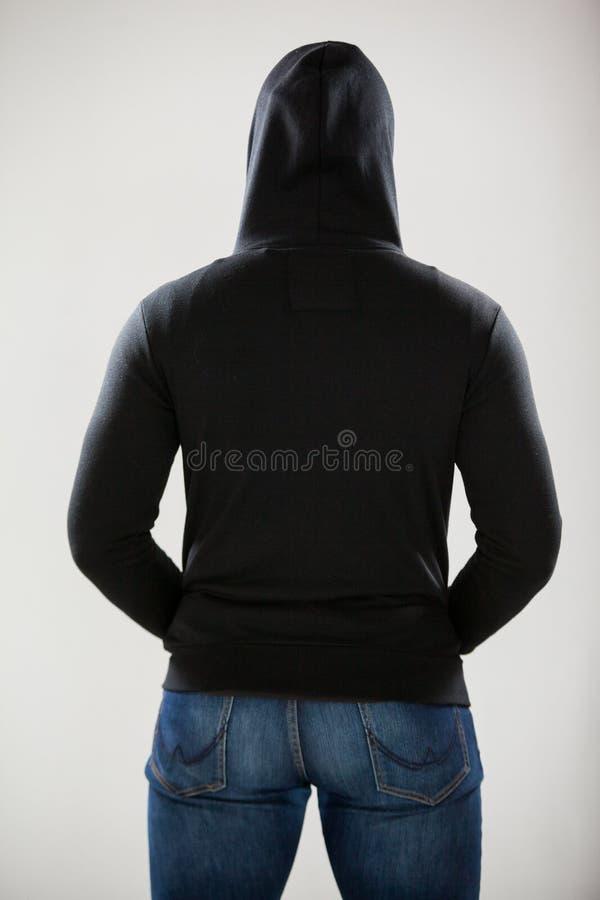 Tylni widok szpieg w hoodie zdjęcie stock