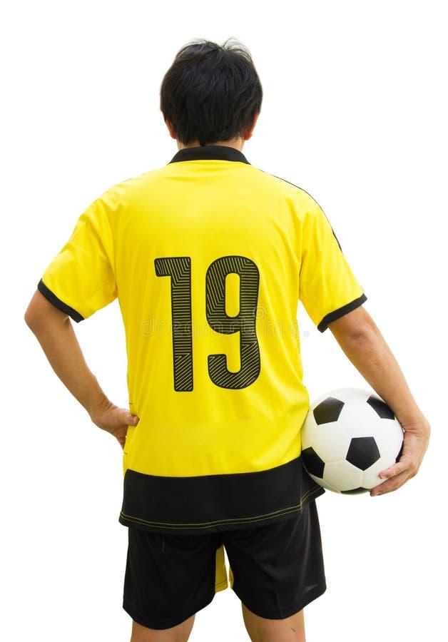 Tylni widoku Vertical Strzelający Azjatycki gracz futbolu Trzyma piłkę fotografia royalty free