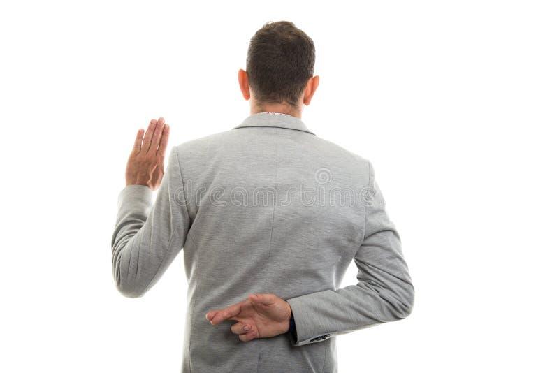 Tylny widok biznesowego mężczyzna seansu imitaci ślubowania gest obrazy royalty free