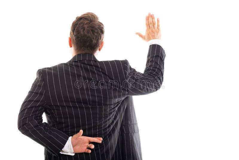 Tylny widok biznesowego mężczyzna seansu imitaci ślubowania gest zdjęcie royalty free