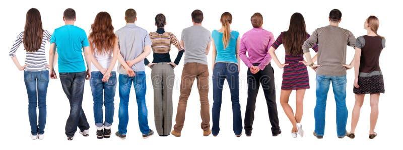 Tylny widok grupy ludzi patrzeć zdjęcia stock