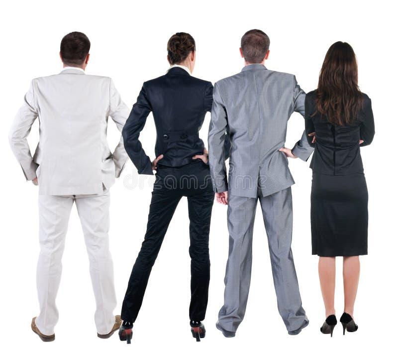Tylny widok ludzie biznesu spojrzeń przy ścianą. fotografia stock