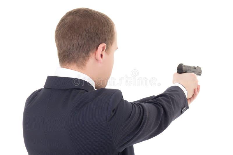 Tylny widok mężczyzna strzelanina z pistoletem odizolowywającym na bielu obrazy stock