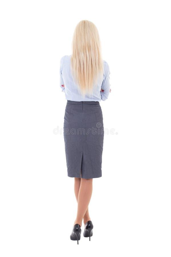 Tylny widok młoda piękna kobieta w garniturze odizolowywającym dalej fotografia royalty free