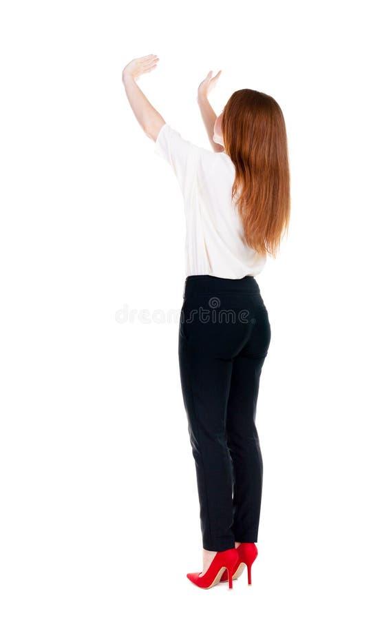 Tylny widok piękni biznesowej kobiety powitania obrazy stock