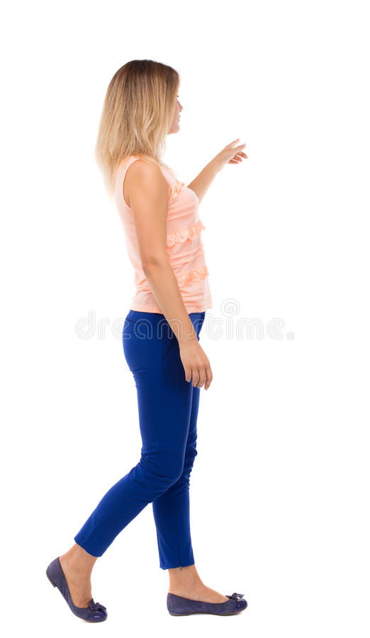 Tylny widok wskazywać chodzącej kobiety fotografia stock