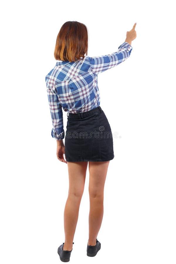 Tylny widok wskazywać kobiety obrazy stock