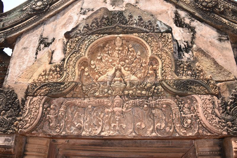 Tympanum at The Holy Temple of Bantaey Srei, Siem Reap, Cambodia. This is a very revered moment in the Indian Mythology when the Demons were winning the battle stock photo