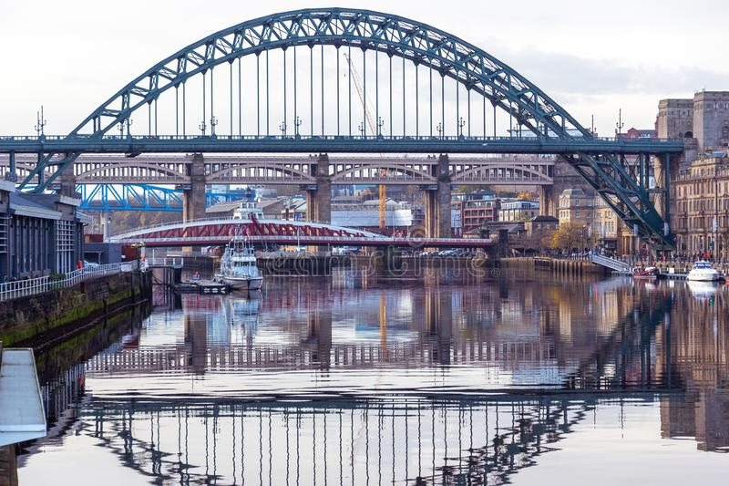 Tyne Bridge mirrored in the River Tyne, Newcastle, UK with Swing, Queen Elizabeth II and High Level bridges in the background stock photos