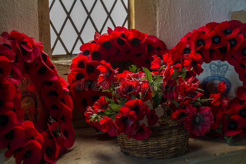 TYNEHAM – DECEMBER 27: British Royal Legion Remembrance wreath. British Royal Legion Remembrance wreaths in church window on December 27, 2015 in Tyneham royalty free stock image