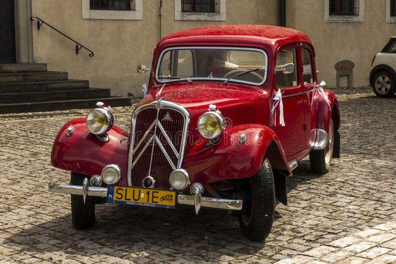 Tyniec, Krakow, Poland, August 3, 2019: Old, antique red car used to transport newlyweds at the wedding stock images