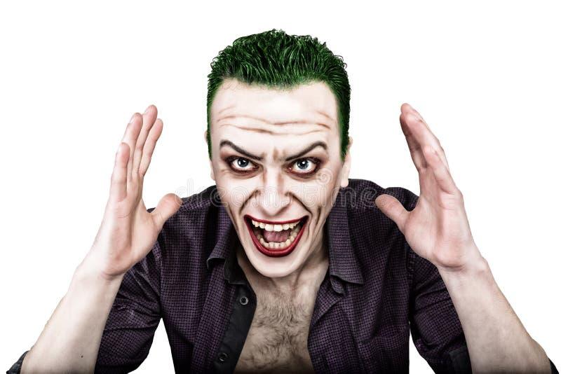 Type avec le visage fou de joker, les cheveux verts et le smike idiot costume carnaval image stock