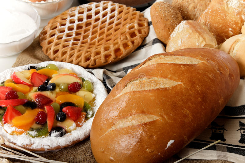 Type of bread, fruits pie. Display of various type of bread and fruits pie. Focus on bread. Studio shot stock photography