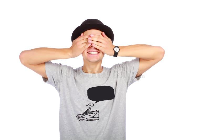 Type dans un chapeau avec les yeux fermés photos stock