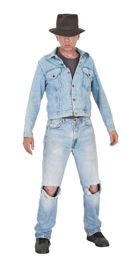 Type de gars dur d'homme portant de vieux vêtements d'isolement photo stock