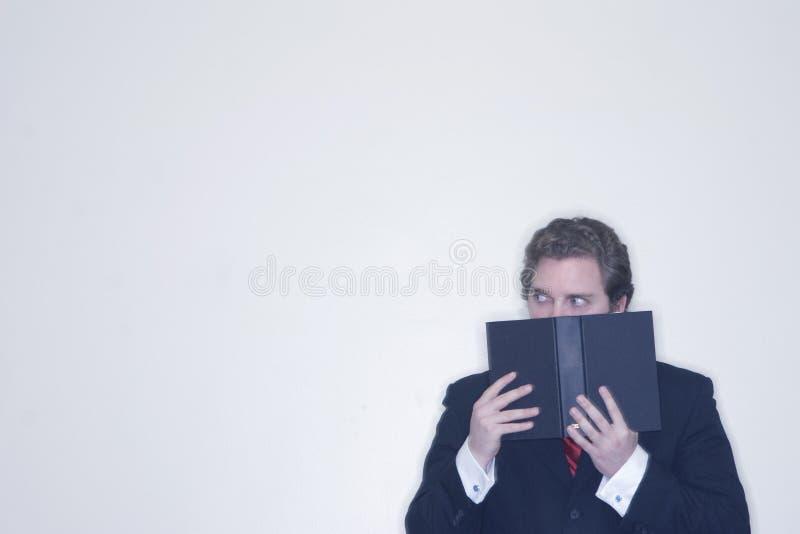 Type derrière le livre photographie stock libre de droits