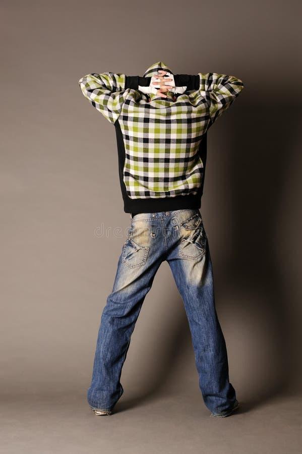 Type en valeur le dos dans la pose arrêtée photo libre de droits