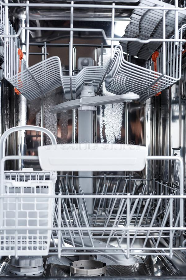 Type of the interior of the dishwasher. Dishwasher parts royalty free stock image